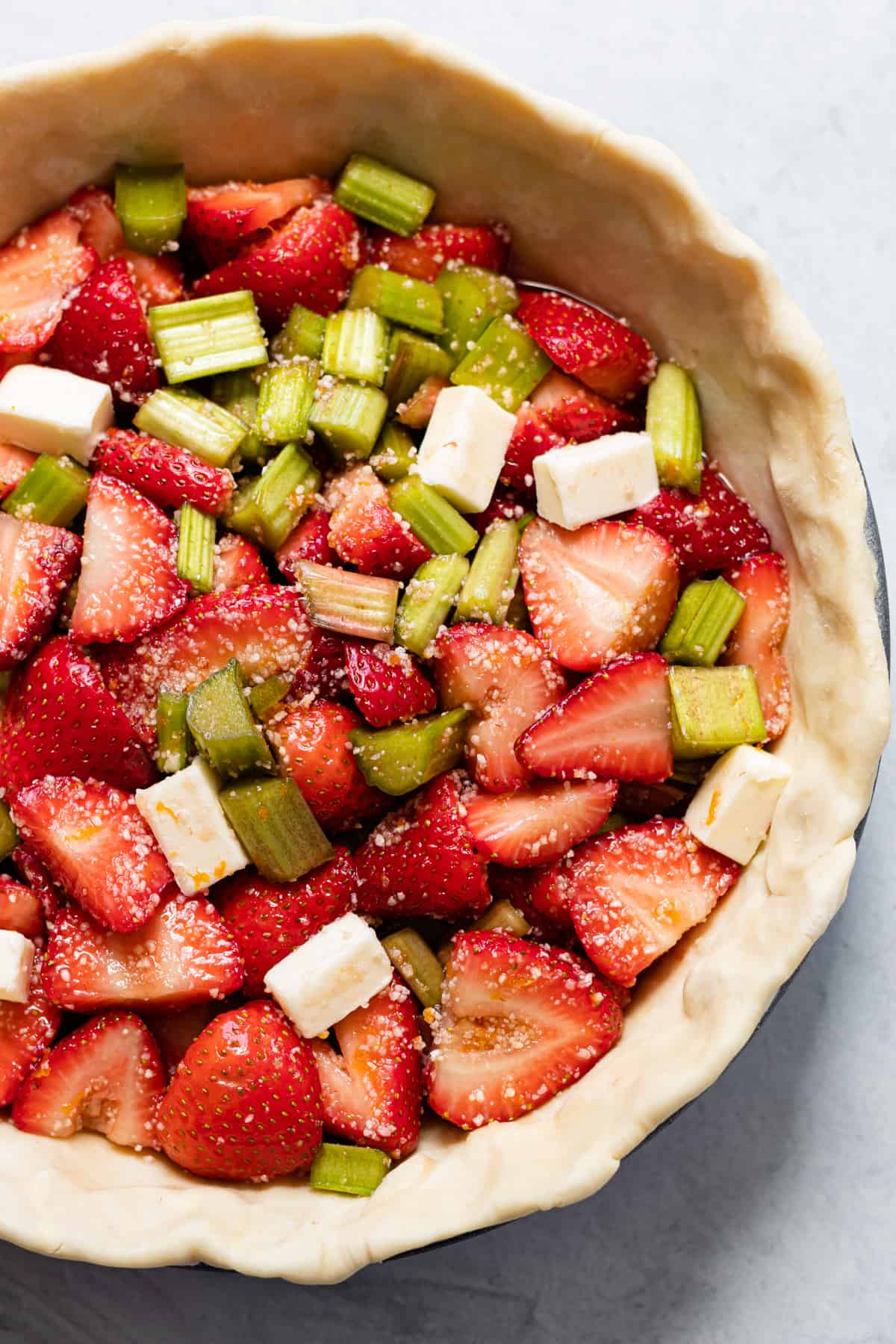 Strawberry rhubarb filling in an unbaked pie shell.