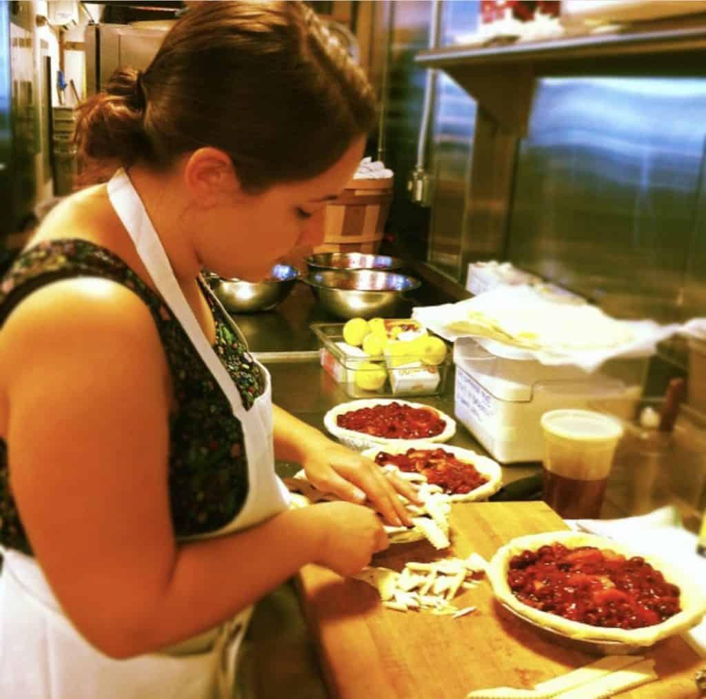 Kelli baking pies in a restaurant