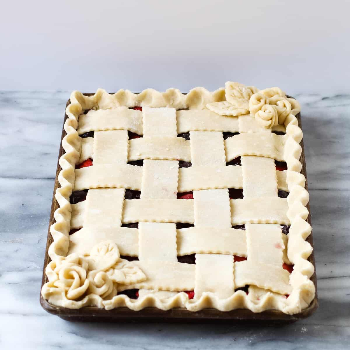 fresh strawberry slab pie with a lattice crust