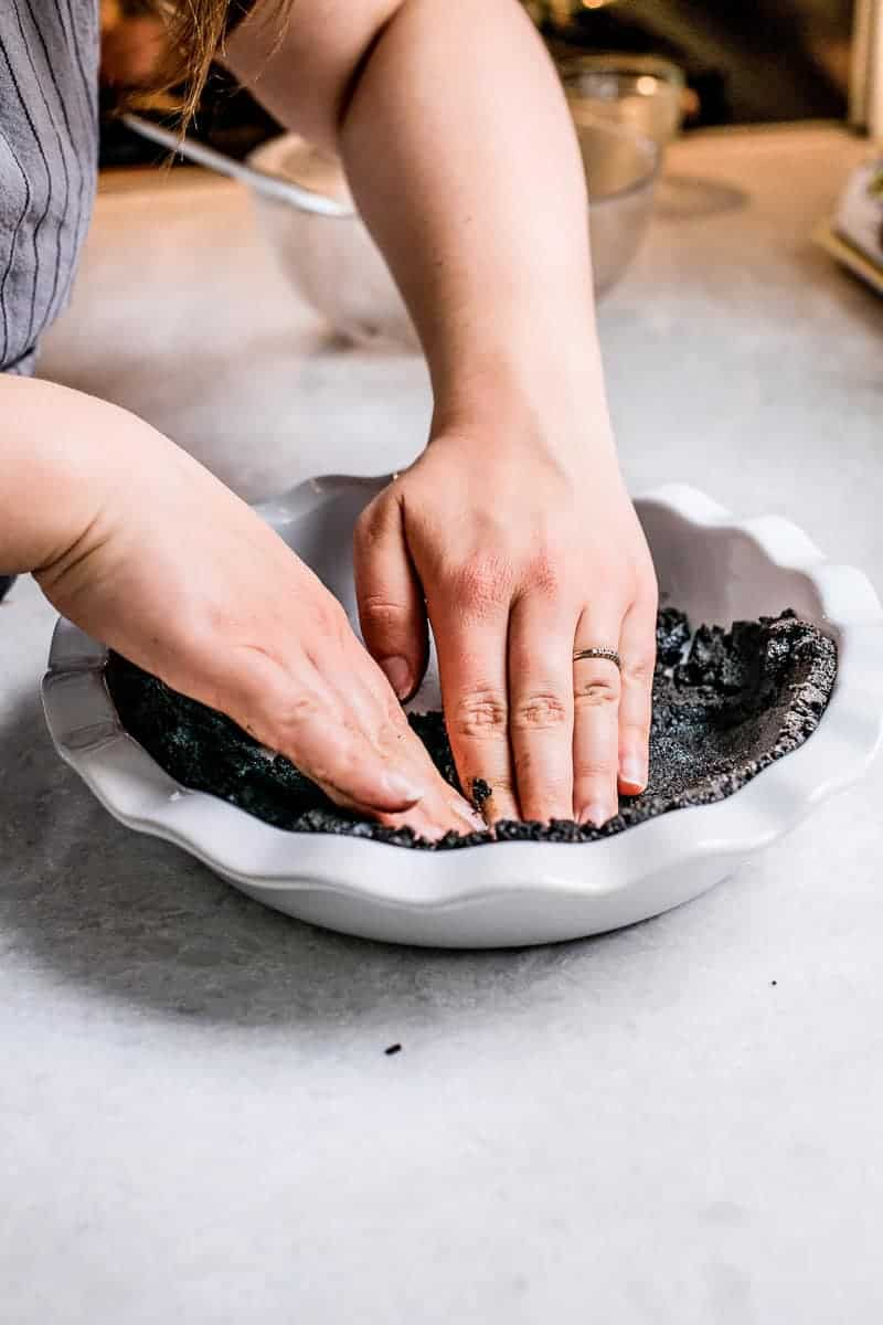 Pressing gluten free chocolate crust into pie pan