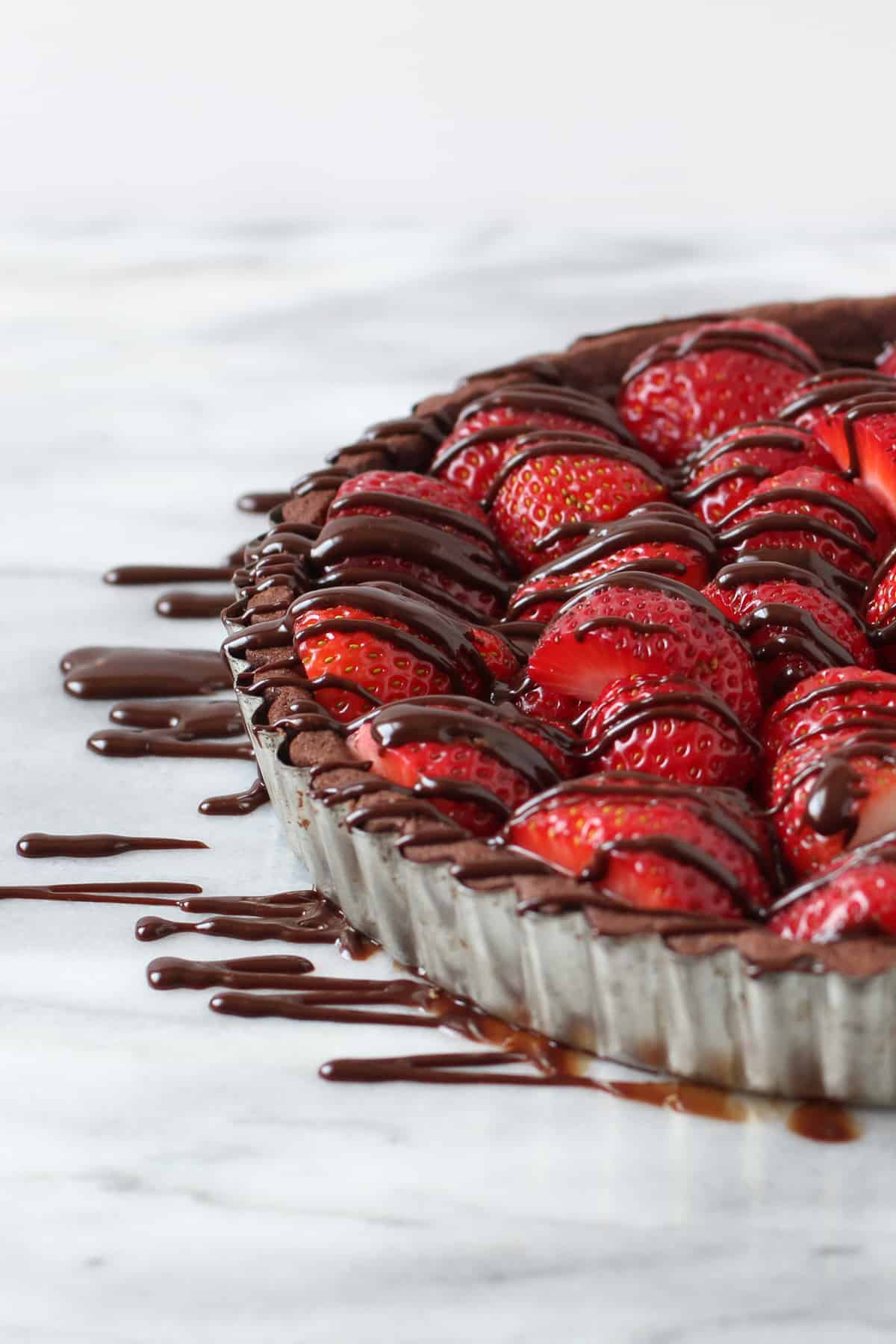 Strawberry pie with chocolate ganache drizzled over the top