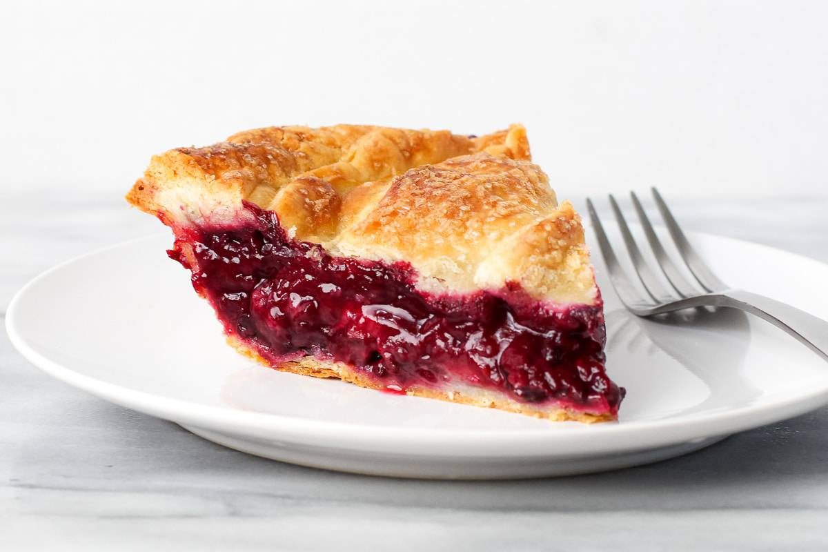 A slice of blackberry pie