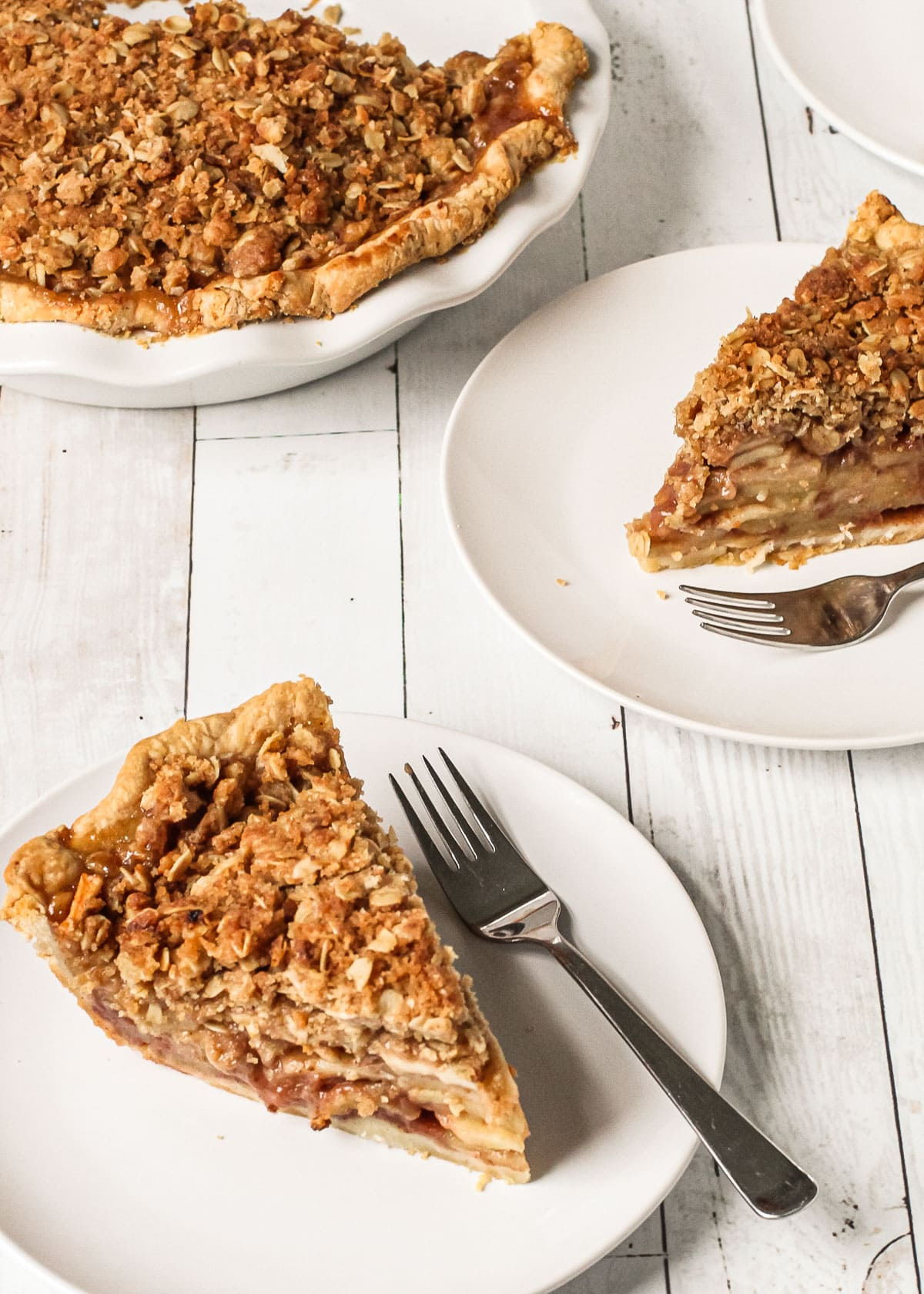 Apple crumble pie slices on a plate.