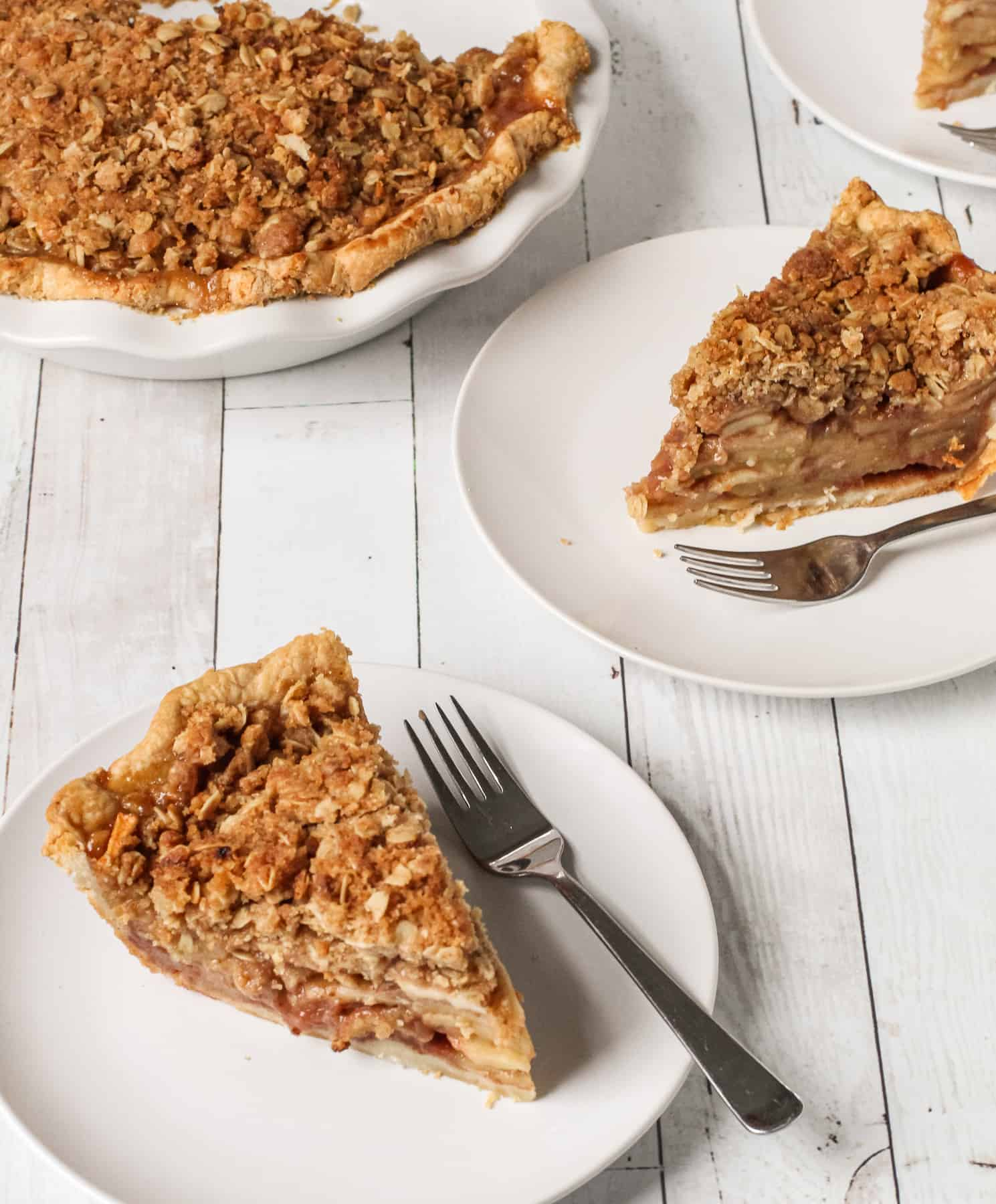 Two slices of apple crumble pie