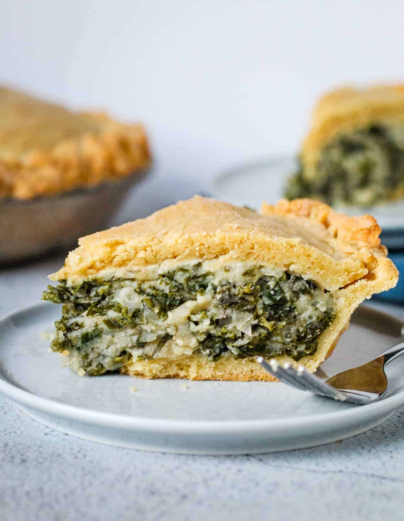 Kale pie on a plate with a fork