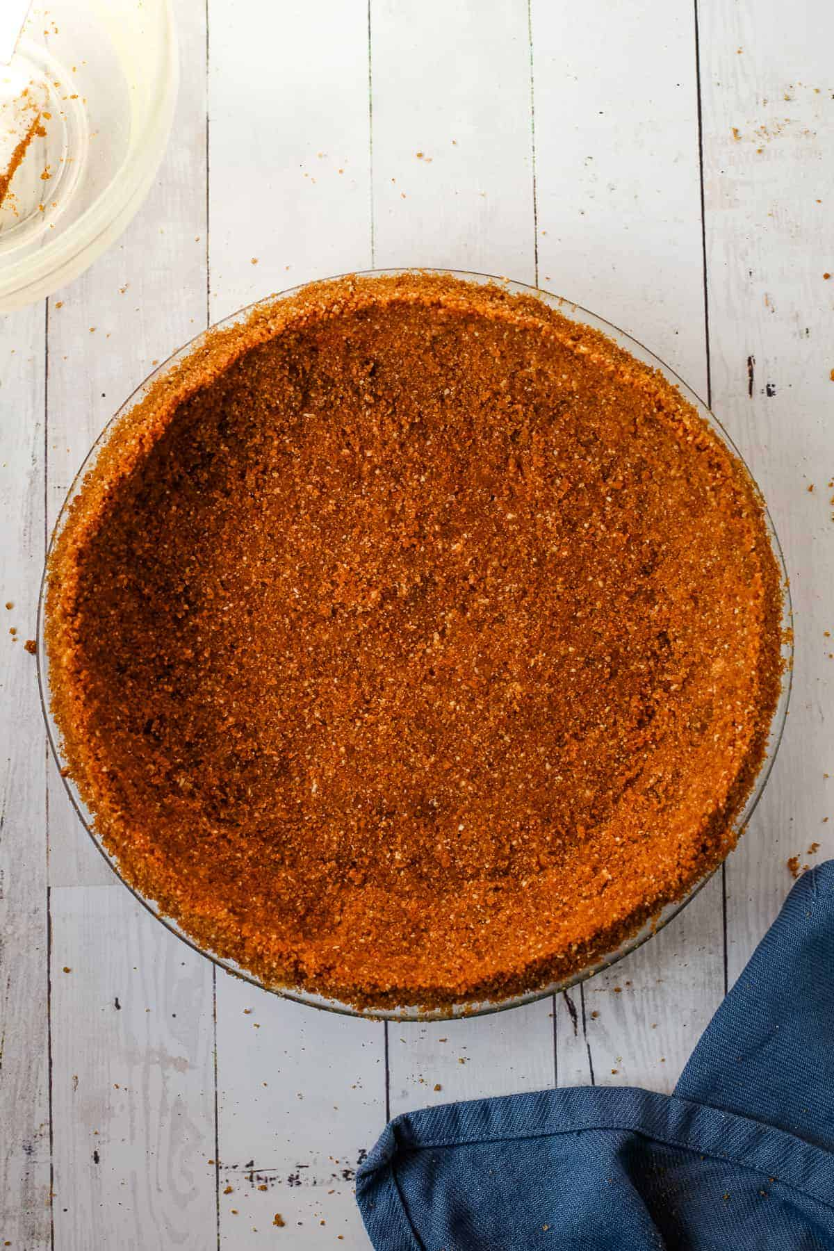 Gingersnap cookie crust in a pie plate