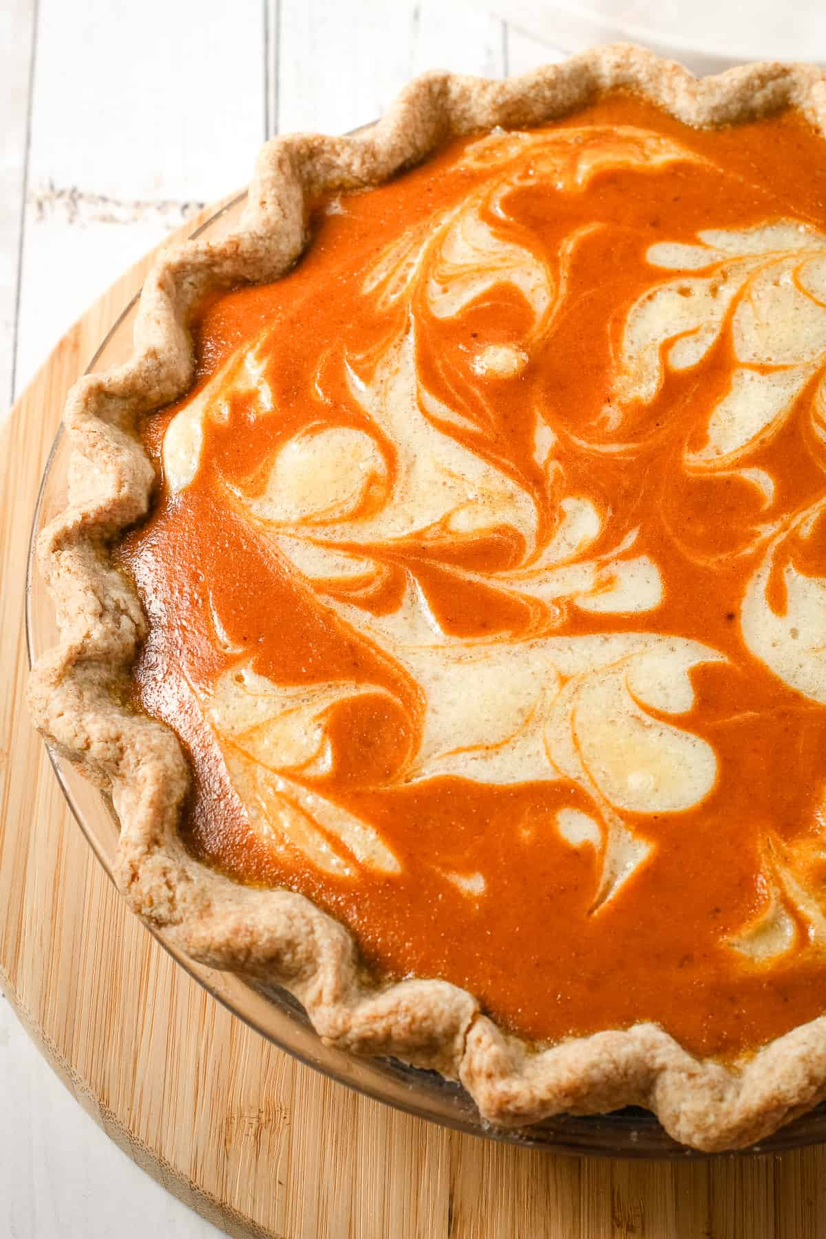 A whole pumpkin pie with mascarpone cheese