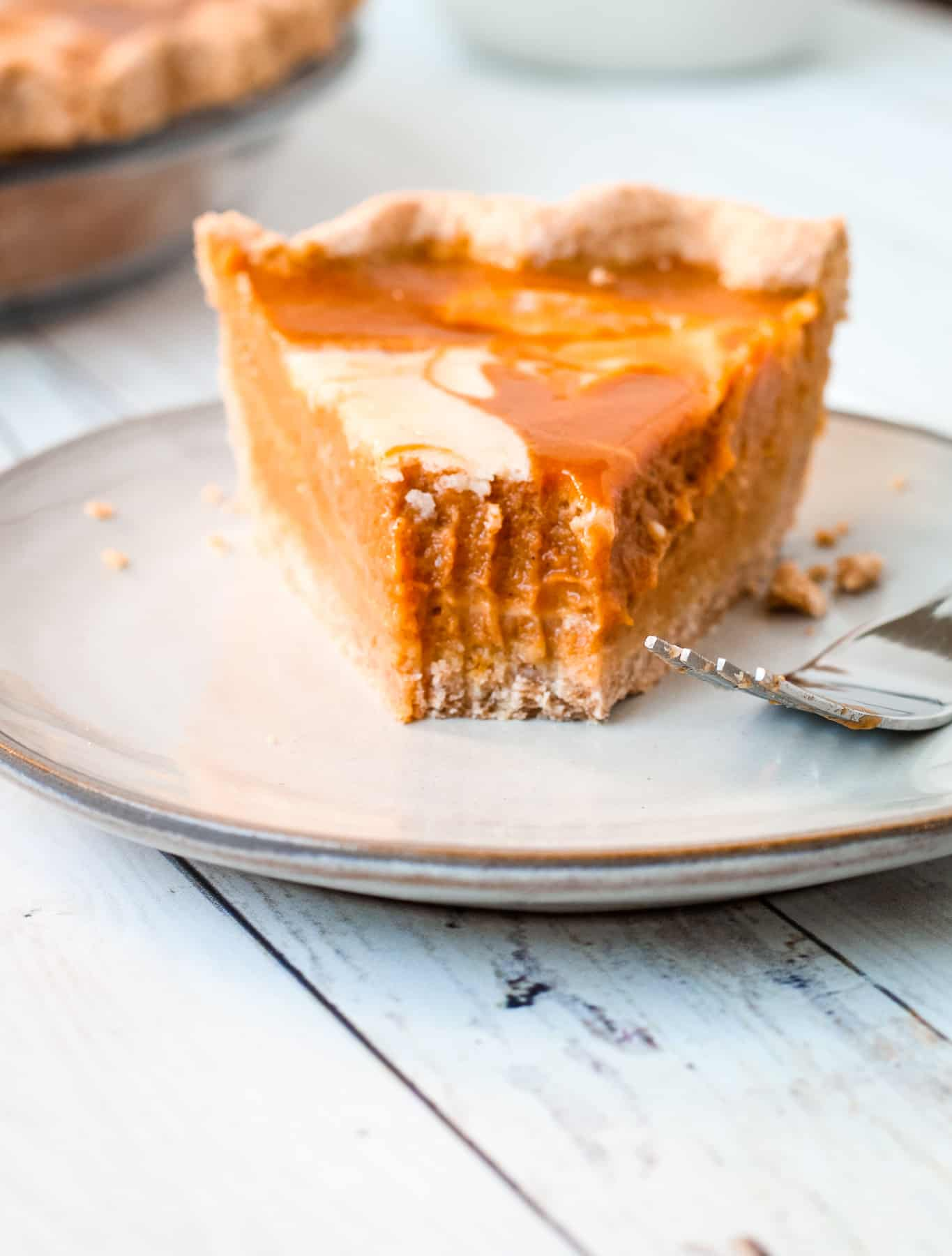 Pumpkin Mascarpone Pie with a bite taken out of it.