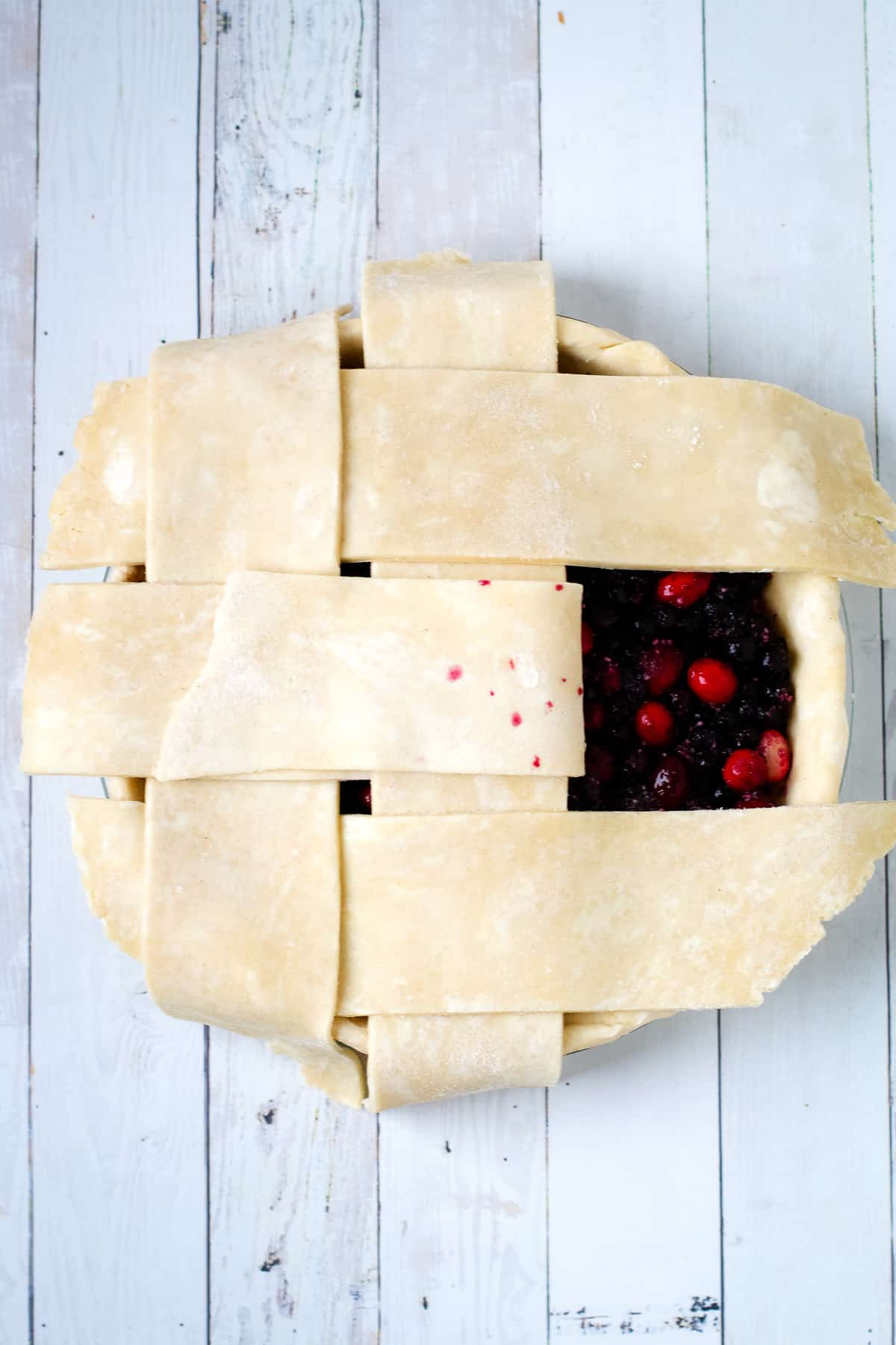 Lattice tutorial on a cranberry blueberry pie