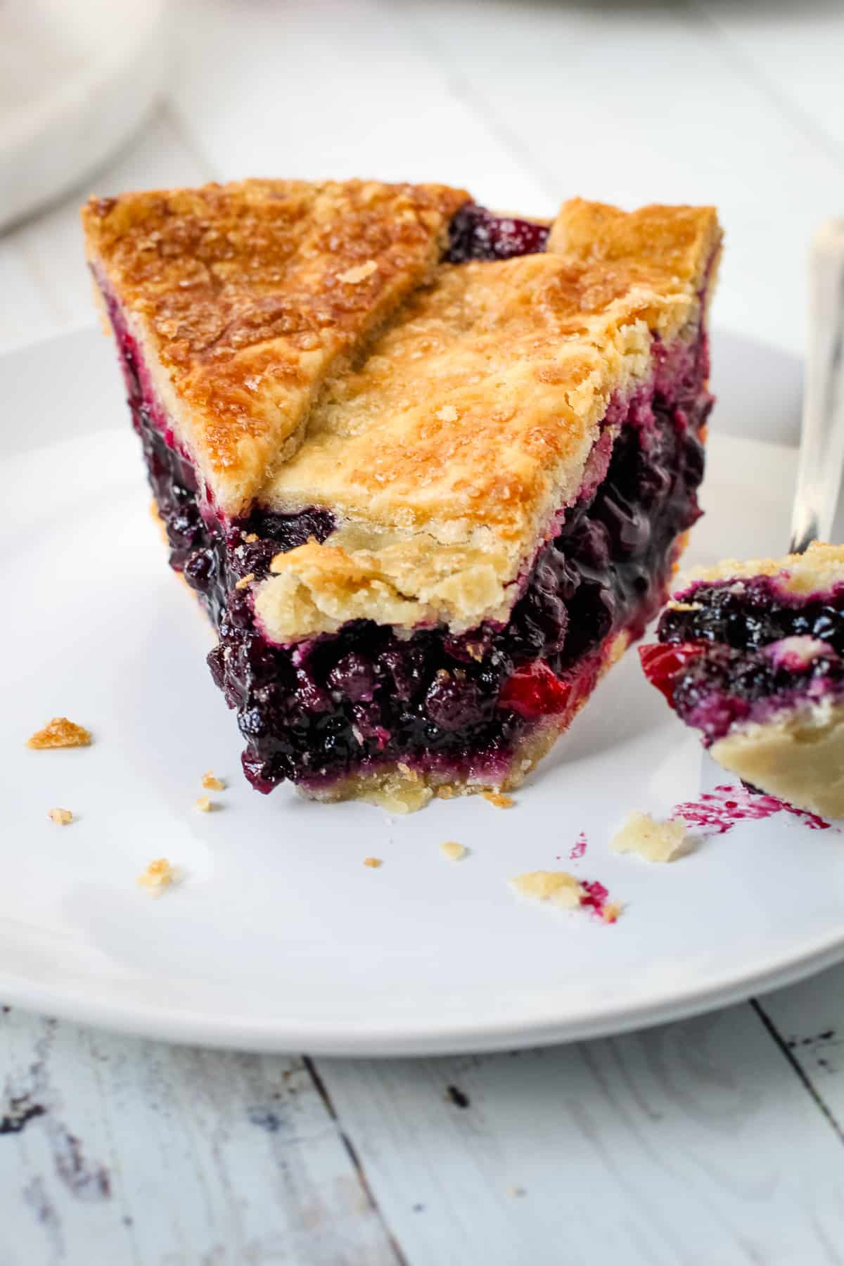 Blueberry and cranberry pie with a fork.