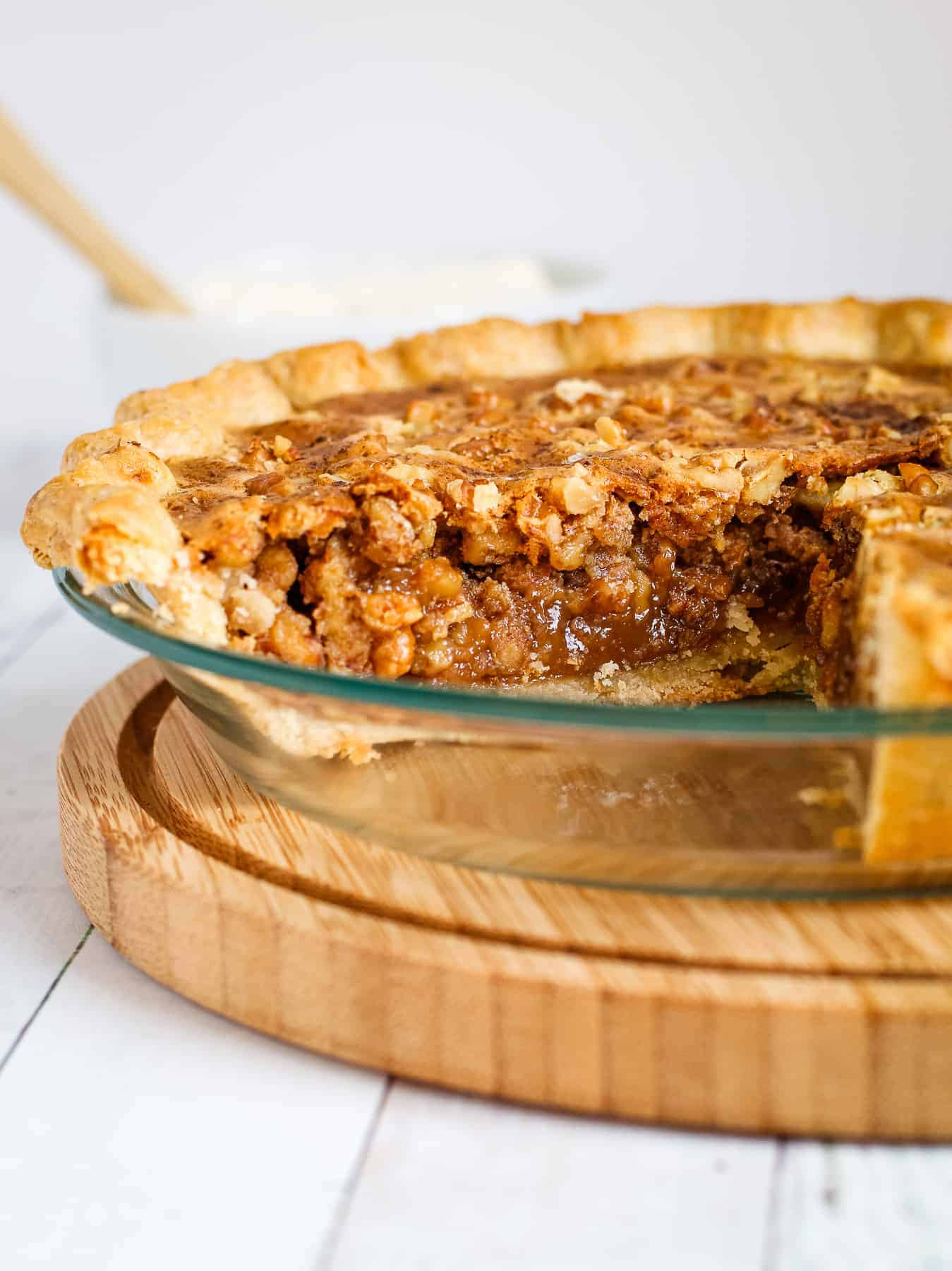 A slice of honey walnut pie in a pie dish