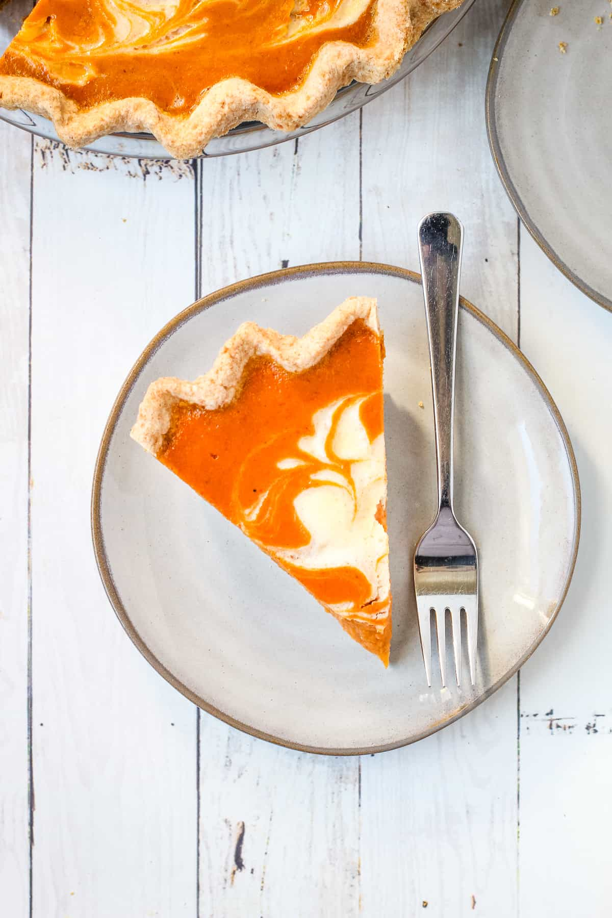 A slice of mascarpone pumpkin pie on a plate