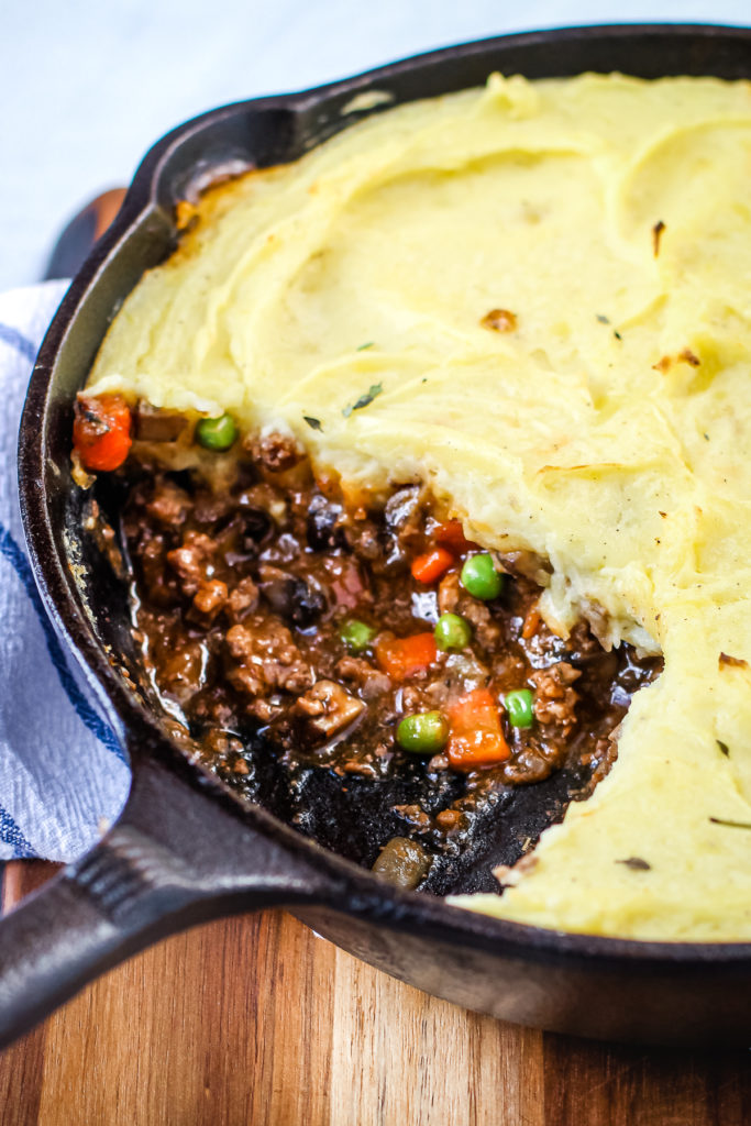 Classic Shepherd's Pie with beef in a cast iron skillet.