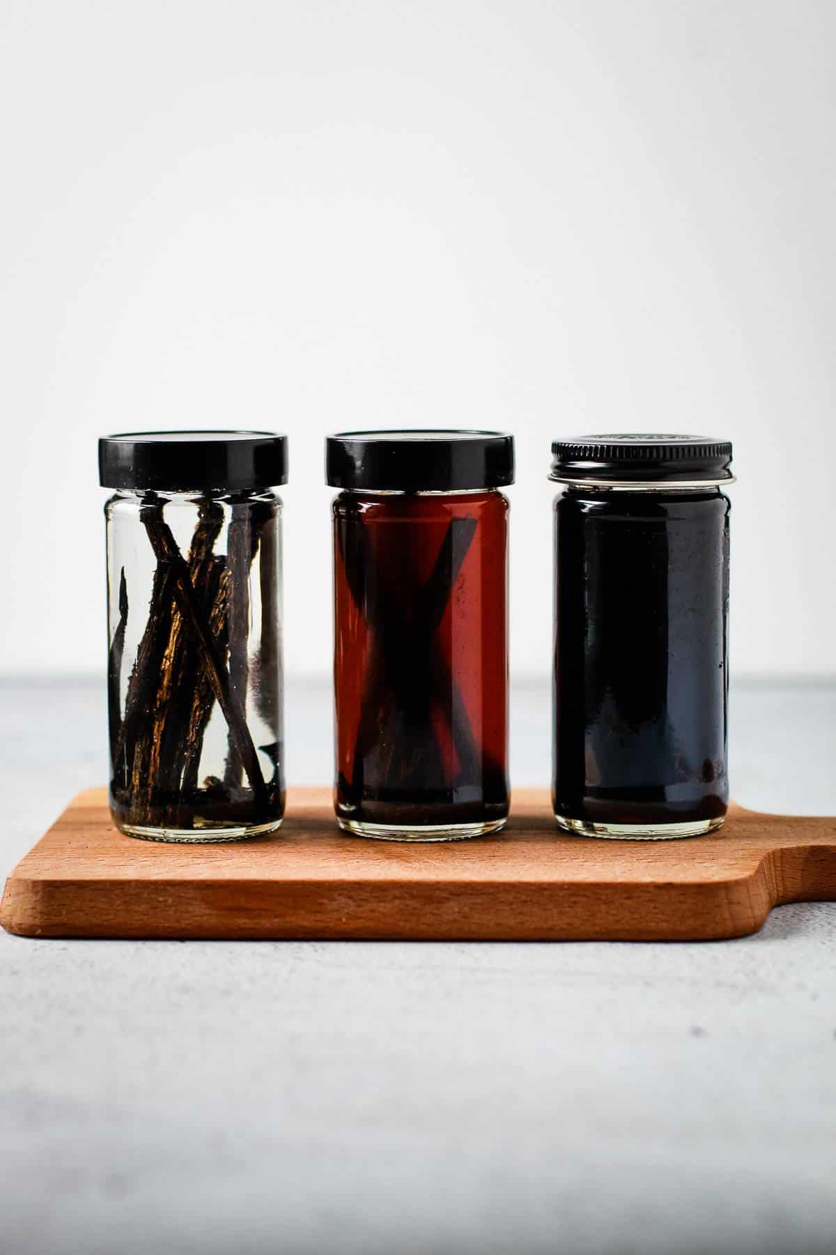The different stages of making vanilla extract.