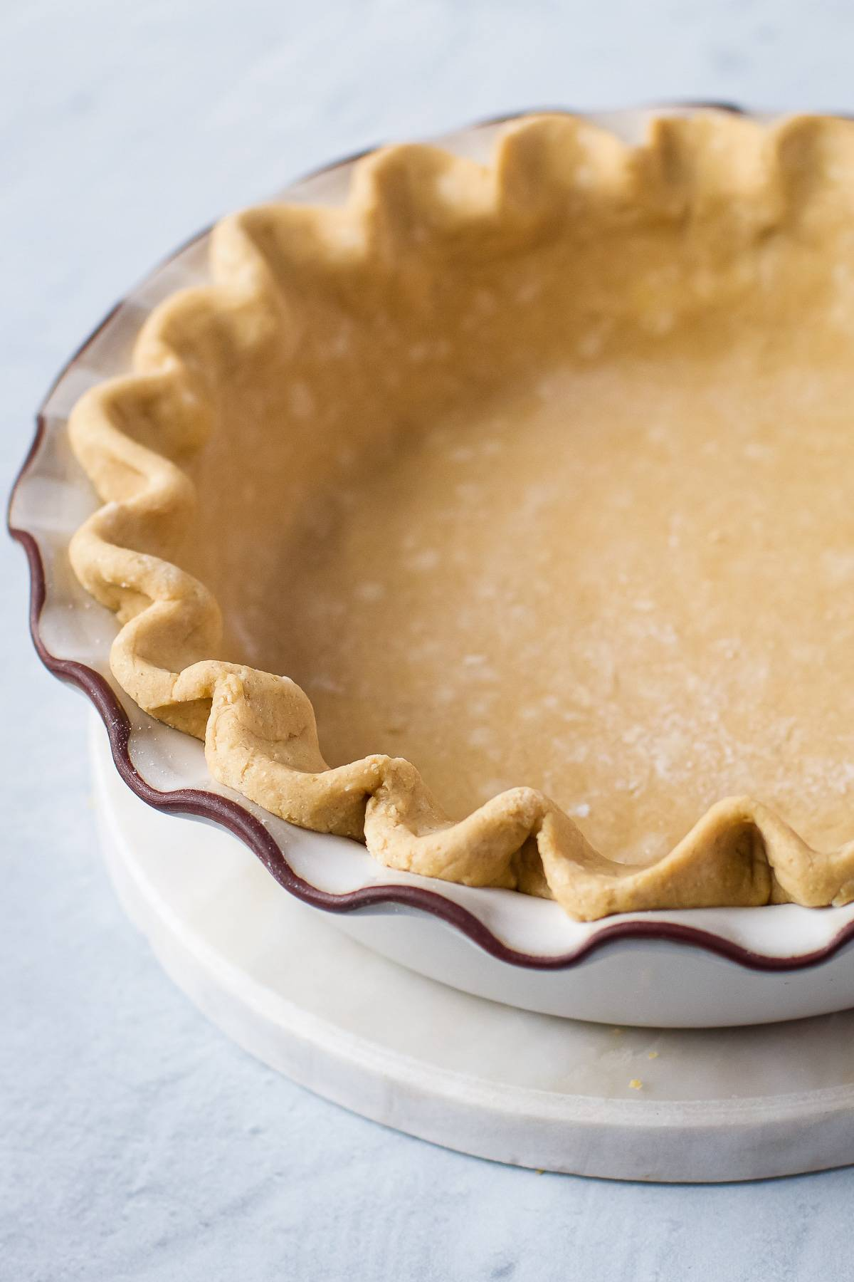 Homemade pie crust in a pretty pie plate.