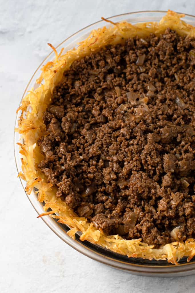 Ground beef inside a potato pie crust to make a cheeseburger pie.