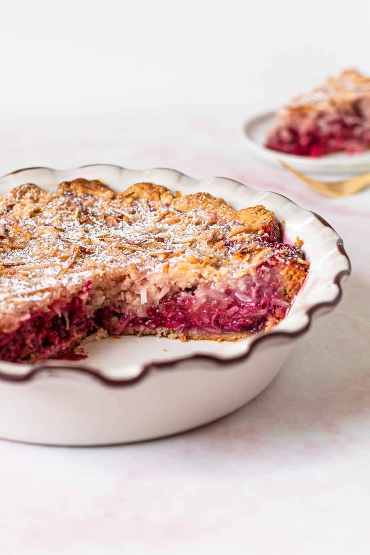 Slices of raspberry pie with coconut streusel topping.