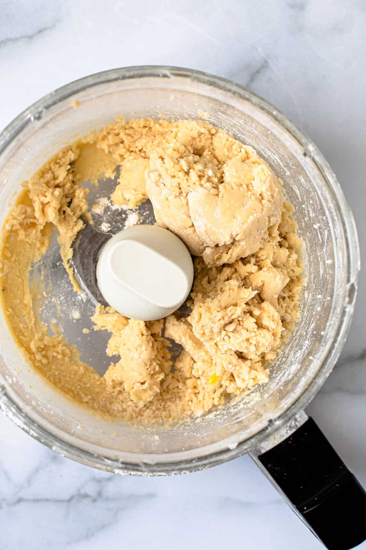 Pate Sablee dough in a food processor.