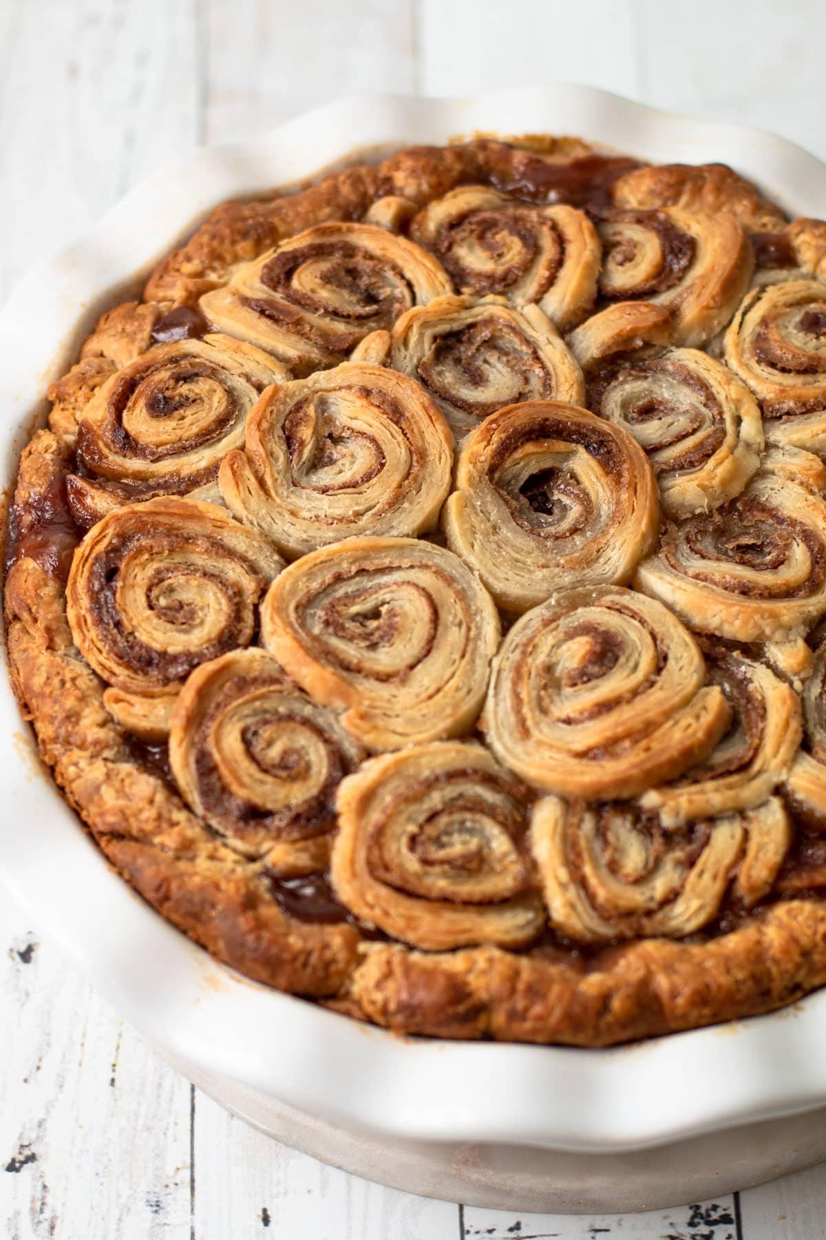 A fully baked cinnamon roll apple pie