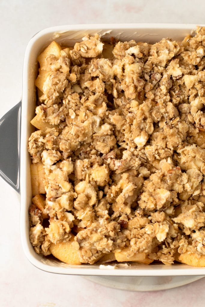 Apple crisp in a pan before baking.