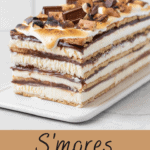 A layered s'mores icebox cake on a platter.