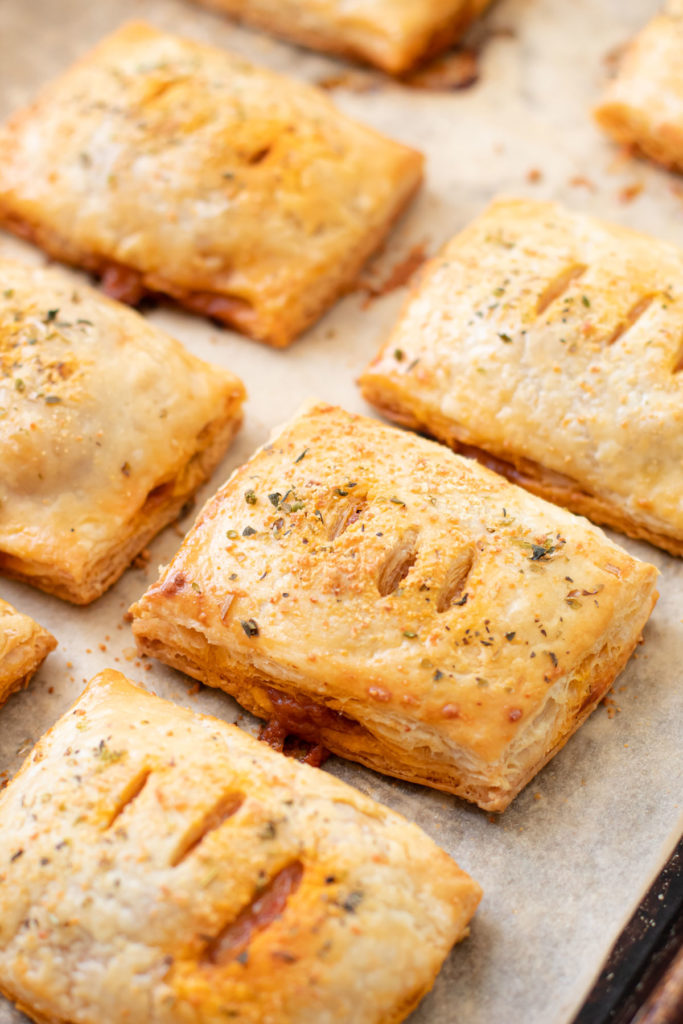 baked hand pies on a tray.