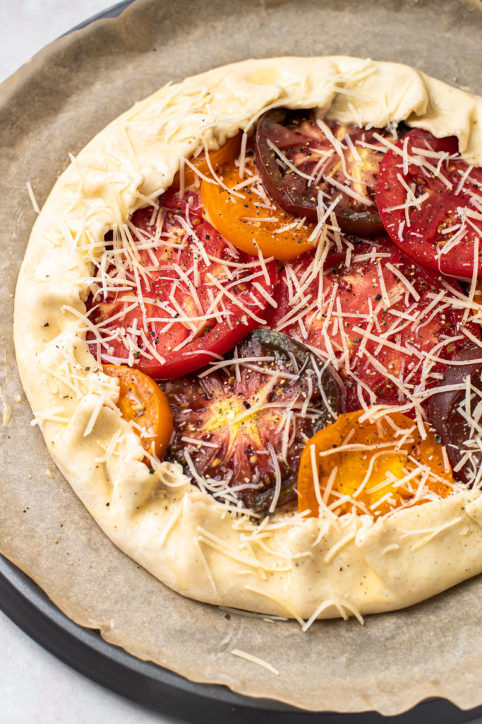 A tomato galette before it is baked.