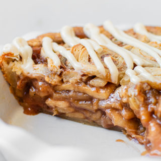 A profile view of cinnamon roll apple pie.