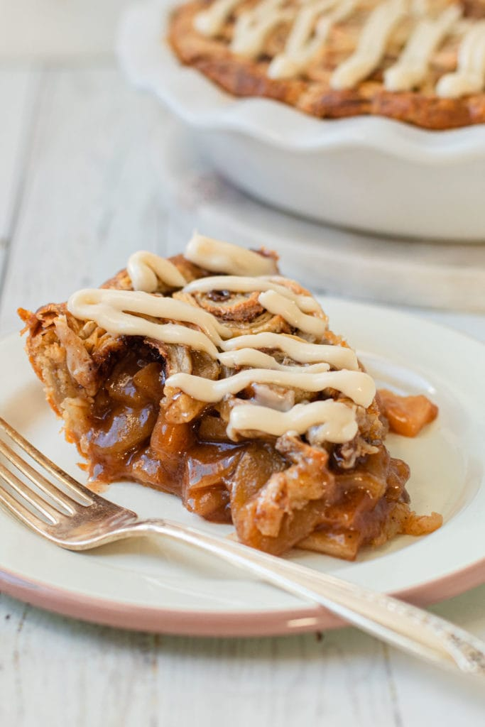A slice of cinnamon roll apple pie.