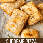 Supreme pizza hand pies with a marinara dipping sauce.