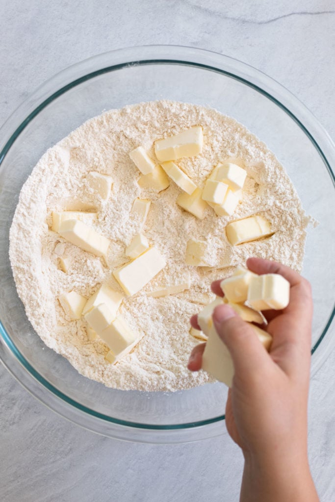 Breaking butter into the flour for homemade pie crust.