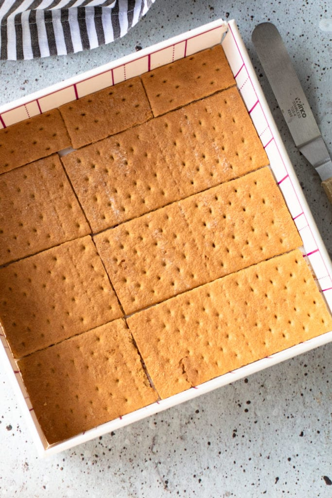 Graham cracker layer in a baking dish,