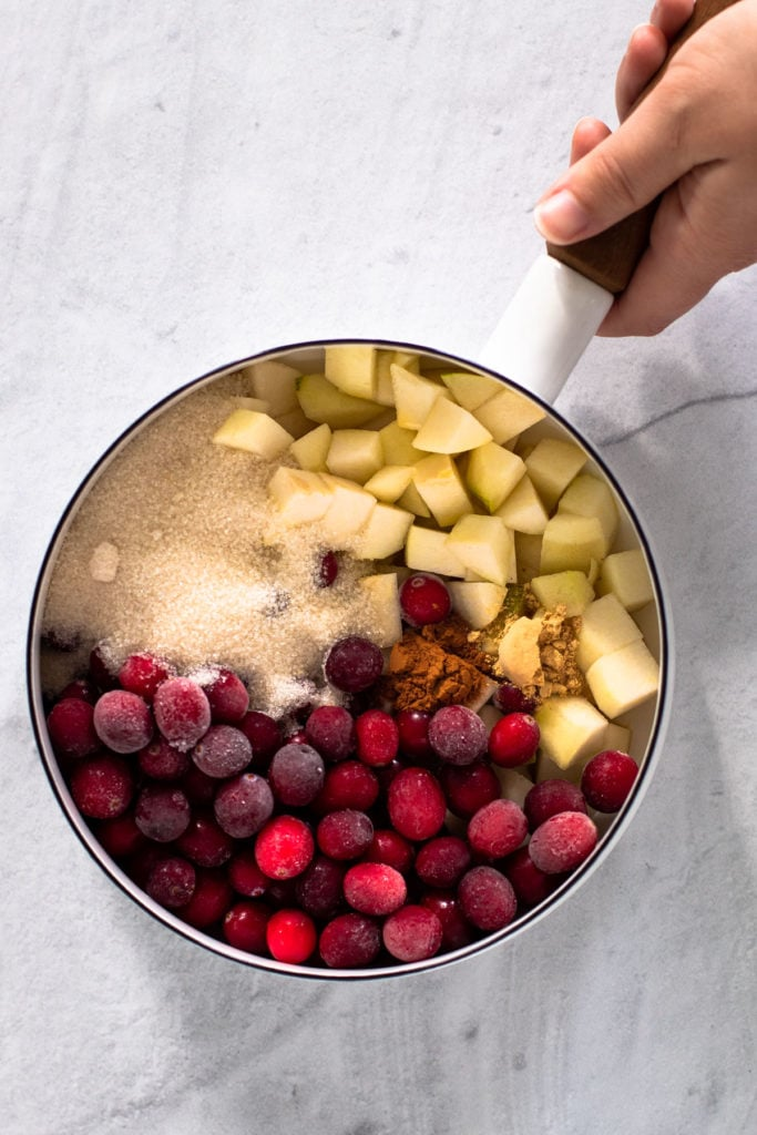 Ingredients for cranberry pear pie filling in a pot.