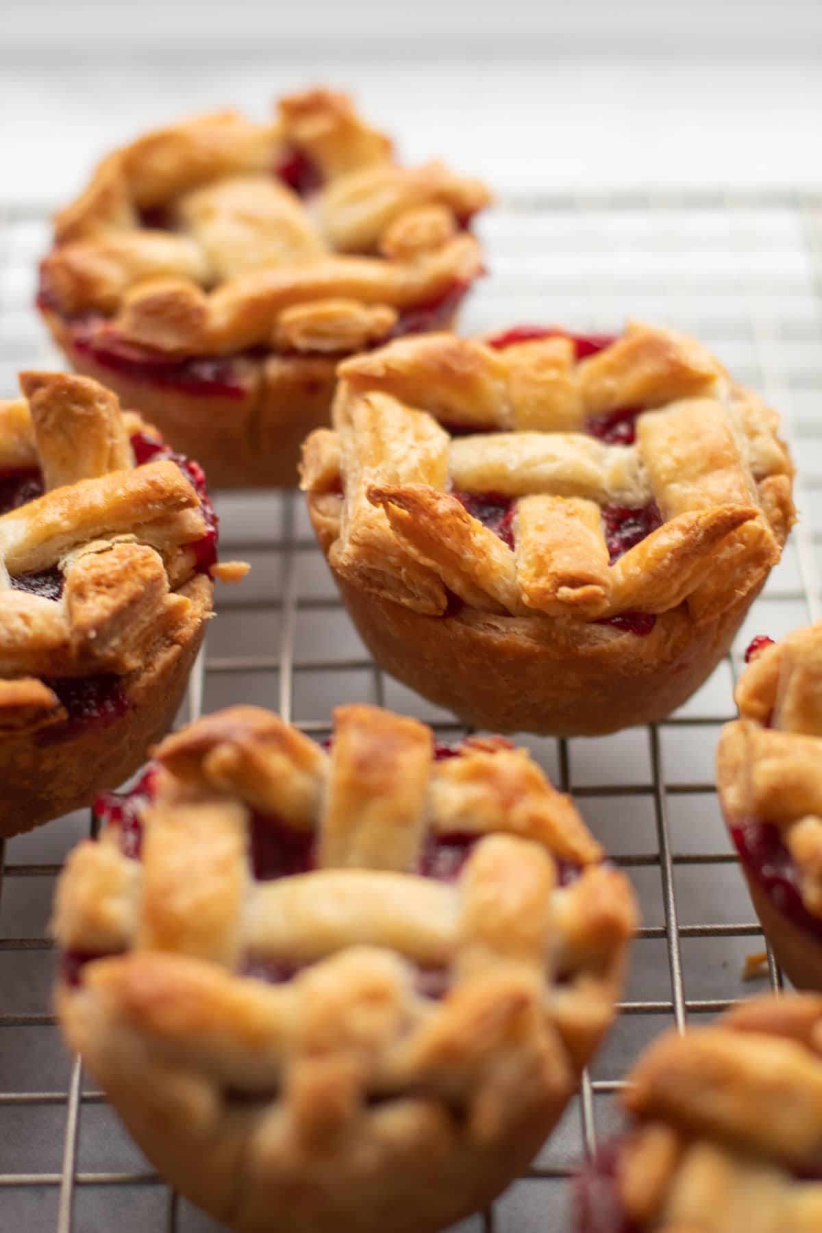 Cranberry Pear Pies cooling on a rack.
