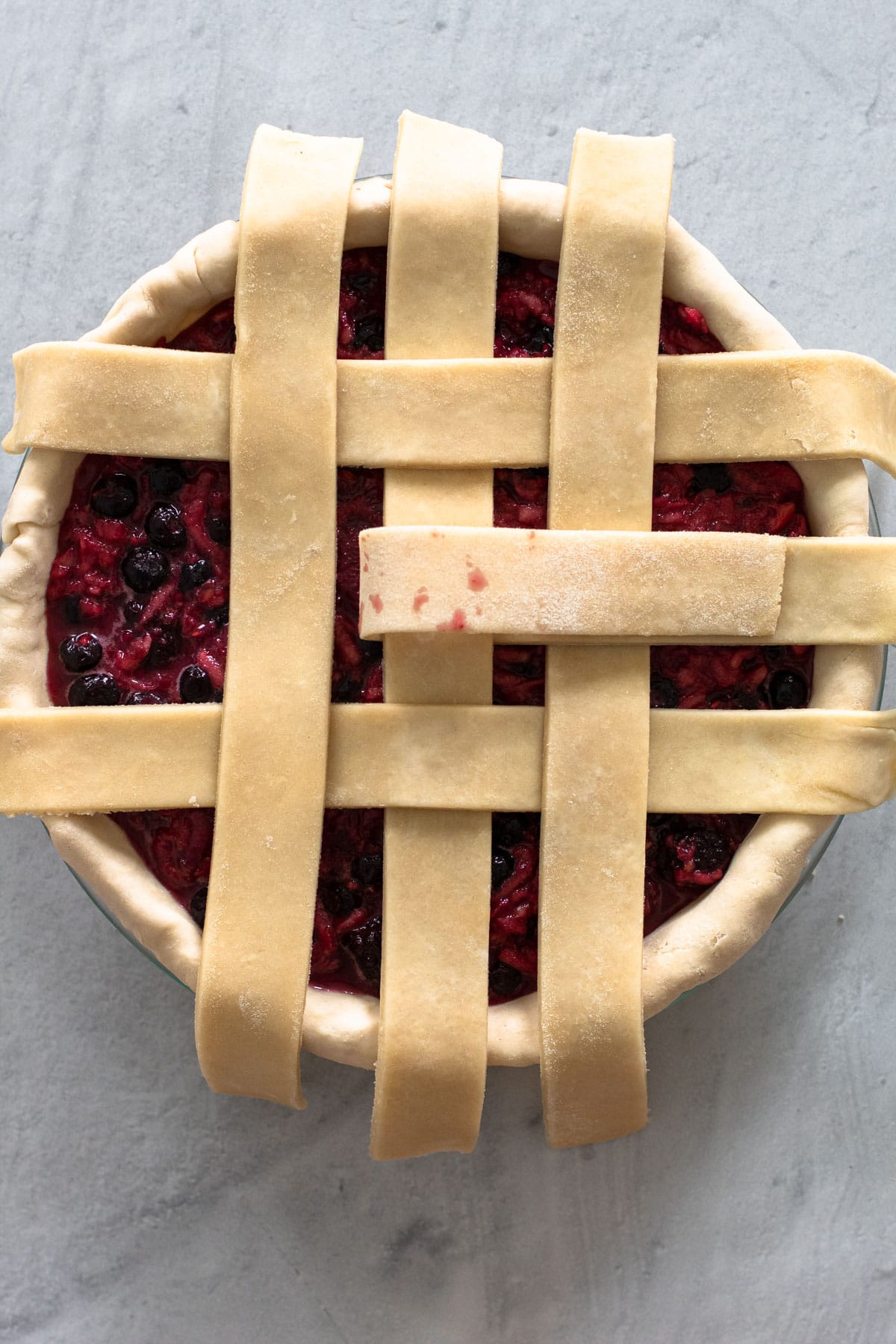 Making a lattice crust for a pie.