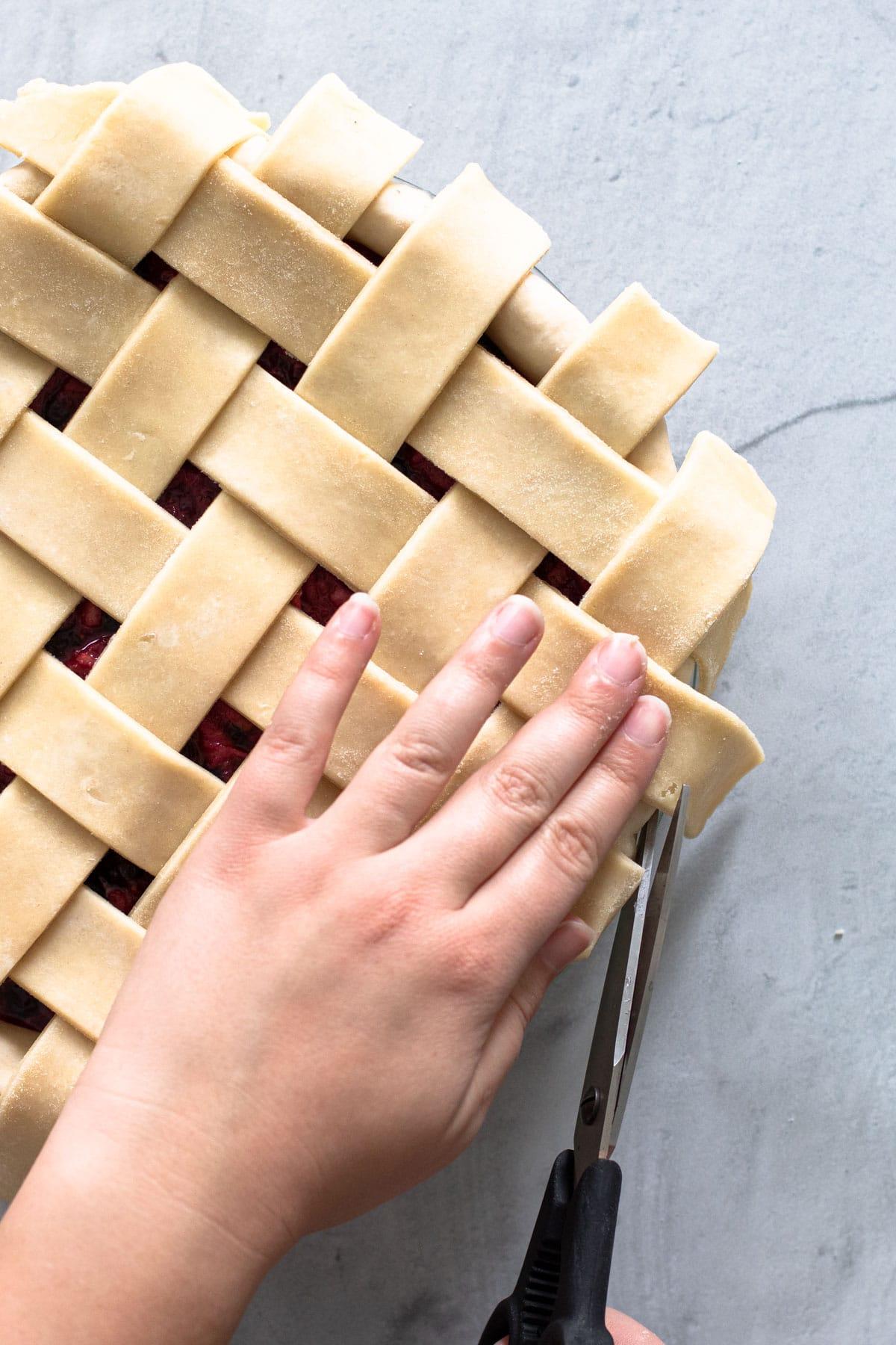 Cutting a lattice pie crust.