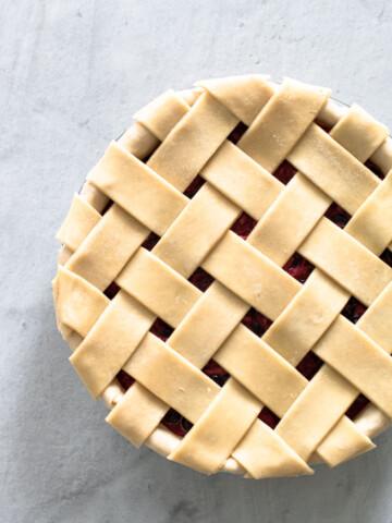 An unbaked lattice pie crust.