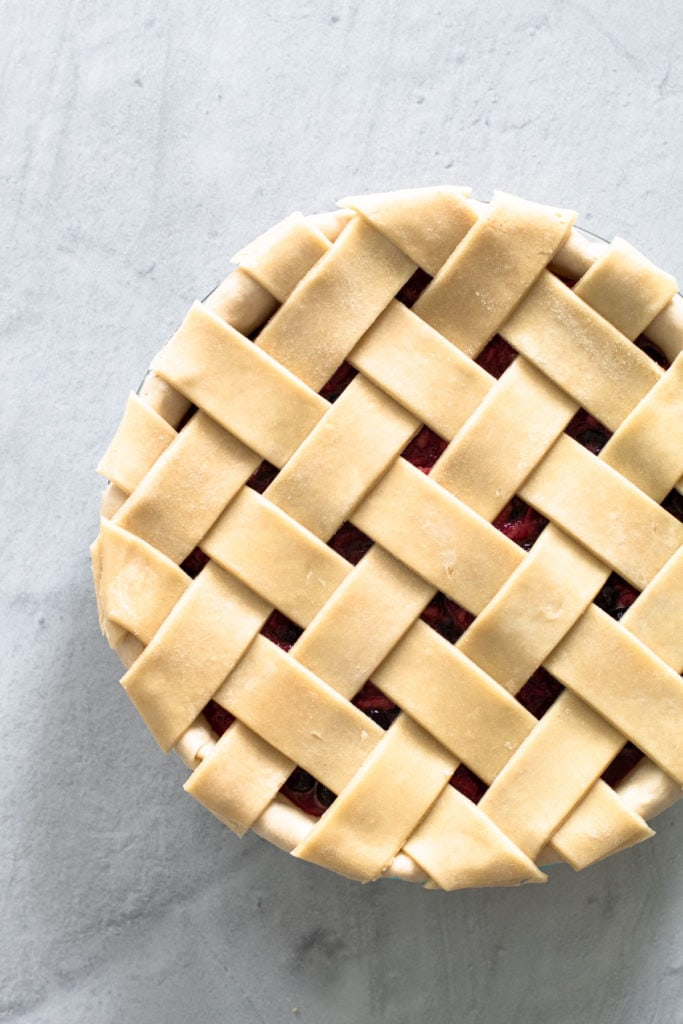 An unbaked lattice pie crust.