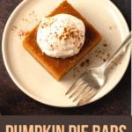 Pumpkin Pie Bars with pumpkin seed shortbread on a plate.