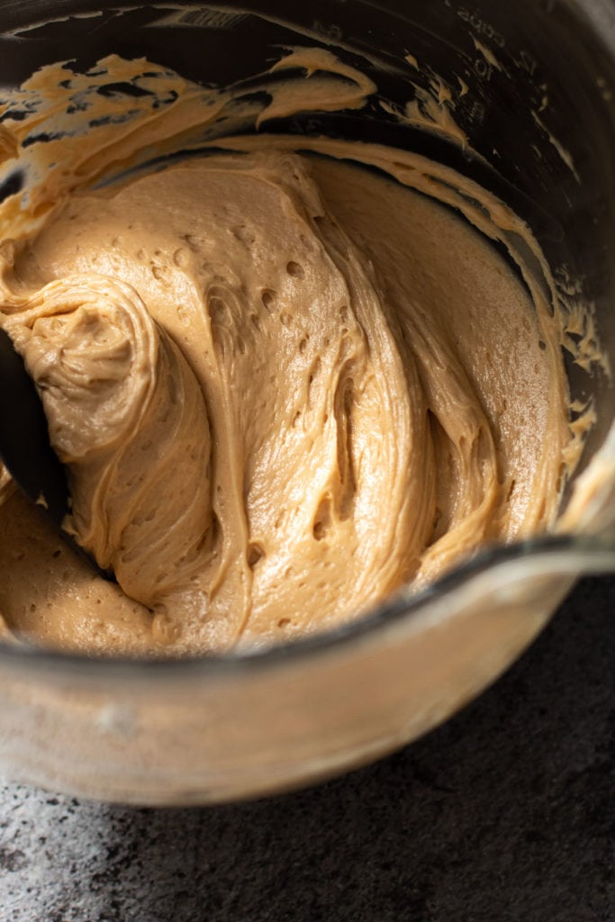 Peanut Butter filling in an electric mixing bowl.