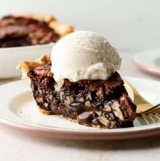 A slice of brownie pecan pie with ice cream on top.