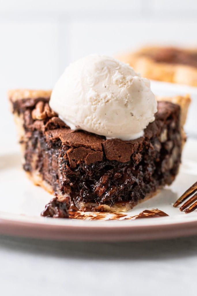 A slice of chocolate pecan pie.