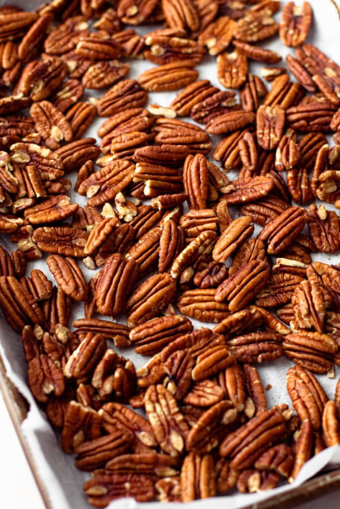 Toasted pecans on a sheet tray.