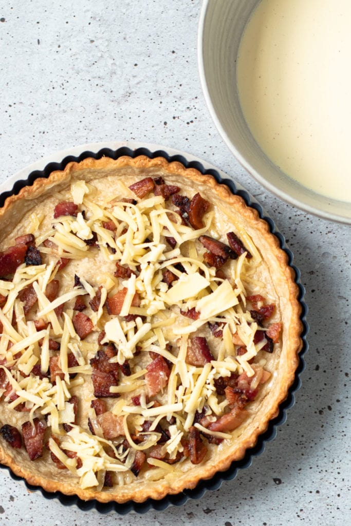 Bacon and cheese in a quiche Lorraine parbaked quiche crust.
