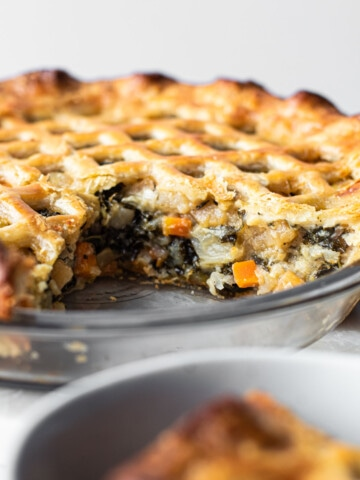 A Winter Veggie Pot Pie with a slice missing.