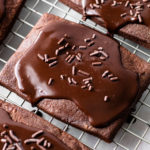 Chocolate Pop Tarts on a cooling rack with chocolate glaze.