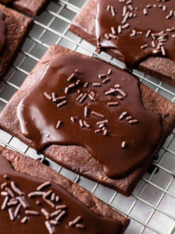 Chocolate Pop Tarts on a cooling rack with chocolate glaze.
