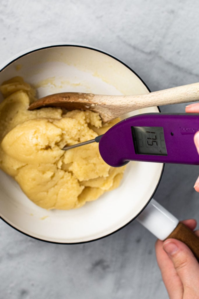 Checking the temperature of choux pastry.