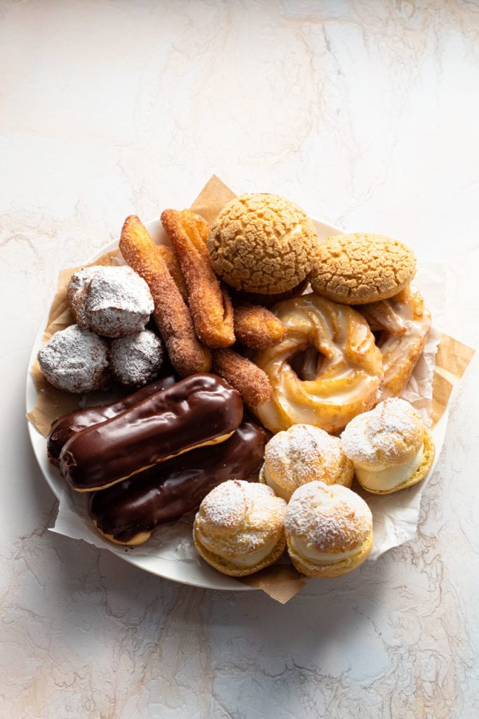 A plate of pastries made from choux pastry.