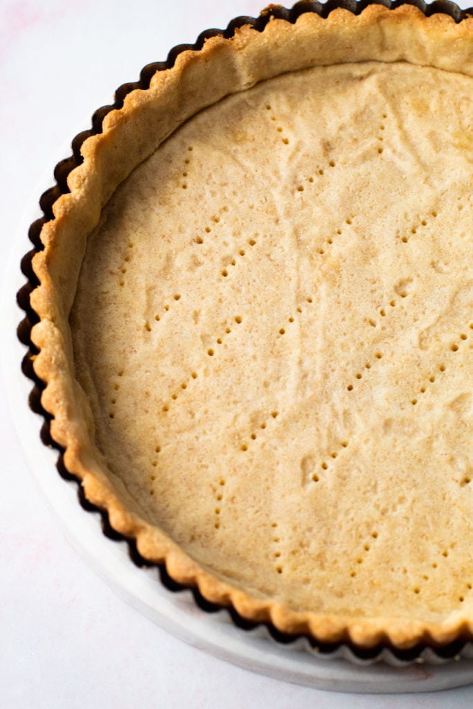A blind baked toasted coconut pastry shell.
